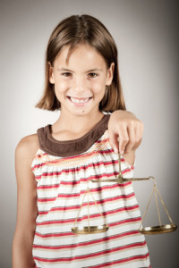 girl holding justice scale